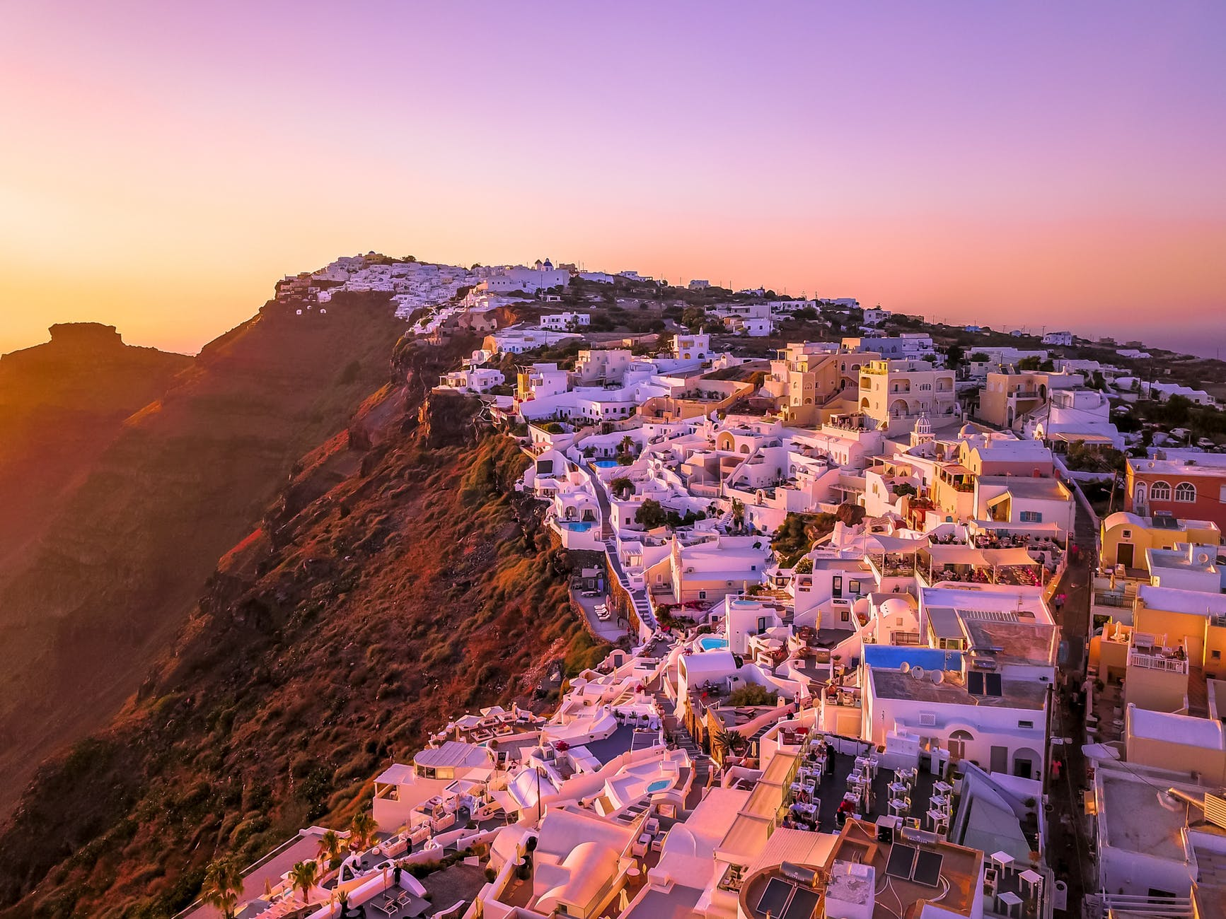 Greek city on a mountain at sunset.