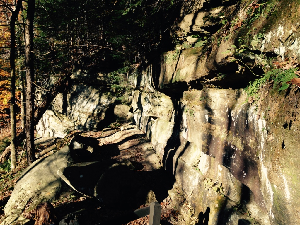 Sunset light on stone on a switchback path in the woods.