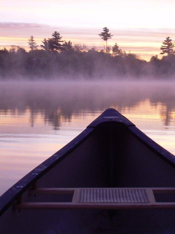 Canoe on a misty lake